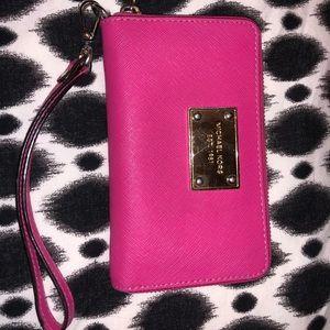 Pink Michael Kors wristlet wallet.